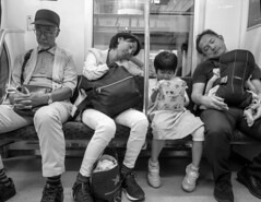 Nap time (kristenscotti) Tags: street tokyo japan city train metro blackandwhite bw family kid baby parents mom woman dad man grandpa grandparents girl bag bench urban candid sleeping nap night olympus child penf pen microfourthirds transportation subway sneakers