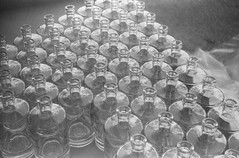 Bottles (Attila Pasek (Albums!)) Tags: glass analogue expired argusc3 hp4 ilford camera bw blackandwhite rangefinder 35mm film bottle