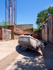 P7200265 (elsuperbob) Tags: detroit michigan rivertown abandoned warehouse boats watertower industrialarchitecture emptyspaces scotthocking boneblack installationart art foundobjects