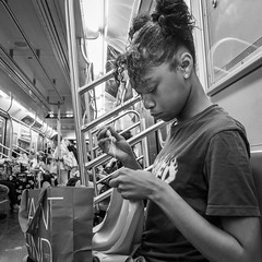 Concentration (John St John Photography) Tags: streetphotography candidphotography youngwoman sewing subwaycar commuters nyctransitauthority newyorkcity newyork ctrain 42ndstreet peopleofnewyork bw blackandwhite blackwhite blackwhitephotos johnstjohnphotography
