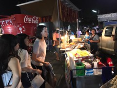girl spying on the food (ChalidaTour) Tags: thailand thai asia asian girls food night market street vendor shop curious spying picture