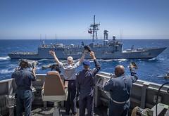 Sailors wave to sailors aboard the Turkish frigate TCG Gokova during a passing exercise. (Official U.S. Navy Imagery) Tags: alliedmaritimecommand marcom nato snmg1 standingnatomaritimegroupone strongertogether ussgravely atlanticocean estamosunidosveseahawkhelicopterflightoperationsmh60mh60saircrewcomfortaviationhsc28helicopterseacombatsquadron28