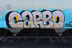 CARBO (TheGraffitiHunters) Tags: graffiti graff spray paint street art colorful benching benched freight train tracks hopper carbo
