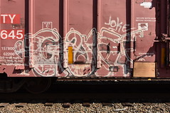 GAUNT (TheGraffitiHunters) Tags: graffiti graff spray paint street art colorful benching benched freight train tracks boxcar gaunt