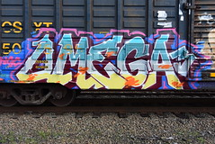OMEGA (TheGraffitiHunters) Tags: graffiti graff spray paint street art colorful benching benched freight train tracks boxcar omega omega3