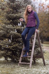 Woman hanging Christmas lights on tree (Rydale Country Clothing) Tags: rydale country clothing fashion british english uk style countryside bauble lights fairly snow tree