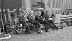 Bridgnorth (leavesandpuddles) Tags: bridgnorth candid monochrome blancetnoir blancoynegro blackandwhite bw atrest lunchtime teabreak svr severnvalleyrailway people shropshire lunchbreak railings railway workers