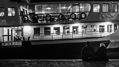 """two little lovebirds - cuckoo to you!"" / dreaming of a big and bright future (Özgür Gürgey) Tags: 169 2016 35mm bw d750 darkcity genesis karaköy nikon samyang architecture candid evening ferry grainy lowlight street istanbul turkey"