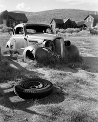 Spare Tyre (tobysx70) Tags: ilford hp5 single use disposable plastic camera 35mm 135 blackandwhite bw film rollfilmweek july 2019 spare tyre bodie california ca tire wheel 1937 chevrolet chevy car rust rusty automobile auto ghost town mining state historic park abandoned arrested decay grass day1 toby hancock photography