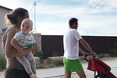 Family Walk (Ktoine) Tags: people street popovka crimea russia baby mother father holding shorts heavy trolley