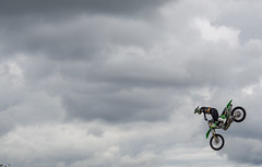 Biker flyer. (CWhatPhotos) Tags: pictures summer that photography flickr day foto image artistic pics picture pic olympus images have photographs photograph fotos which contain 2019 cwhatphotos sky bike clouds fly flying durham police motorbike wise motorcycle motorbikes stunt bikewise green kawasaki bikers