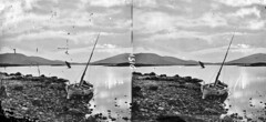 Song of the lonely boatman (National Library of Ireland on The Commons) Tags: thestereopairsphotographcollection lawrencecollection stereographicnegatives jamessimonton frederickhollandmares johnfortunelawrence williammervynlawrence nationallibraryofireland sea rocks dinghy mast lake mountains