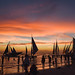 Sailboats docked during golden hour at Boracay