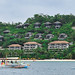 Pumpboat passing by the hidden luxury hotels