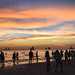 People hanging around the beach during golden hour