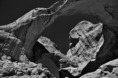 Curves, Shapes and Patterns Under the Double Arch (Black & White, Arches National Park) (thor_mark ) Tags: archesnationalpark azimuth330 blackwhite blueskies butte canyonlands capturenx2edited centralcanyonlands colorefexpro coloradoplateau day6 desert desertlandscape desertmountainlandscape doublearch doublearchtrail elephantbutte highdesert intermountainwest landscape layersofrock lookingnw naturalarch naturalarches nature nikond800e outside portfolio project365 rockformations sunny utahhighdesert utahnationalparks2017 ut unitedstates