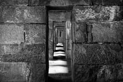 Through Many Doors (Eric Kilby) Tags: georgesisland bostonharbor boston harbor island fortwarren fort stone hallway shadows doorways