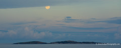 The moon above Montague Island & Lighthouse, off the coaust of NSW at Narooma (Peter.Stokes) Tags: colour nature clouds landscape landscapes australian australia nsw newsouthwales sea sky water outdoors photography photo vacations lighthouse island saltwater narooma montagueisland montagueislandlighthouse