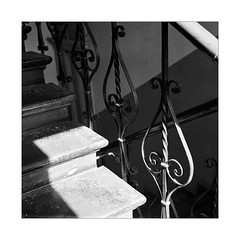 Ornaments of Light (Thomas Listl) Tags: thomaslistl blackandwhite biancoenegro noiretblanc monochrome yashicamat124g mediumformat mediumformatfilm 6x6 square film filmphotography analog kodak trix kodaktrix indoor staircase light shade ornaments metal contrasts lines geometry geometric interior 120