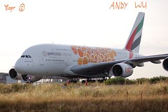 Airbus A380 Emirates Orange Livery (Starkillerspotter) Tags: a6eou emirates orange a380 heavy aircraft airbus paris cdg roissy airport grass sun