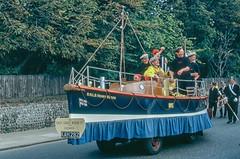 Carnival float, Cromer, Norfolk in 1962 (Gösta Knochenhauer) Tags: scanned colorslide analog analogue 1962 july film kodachrome voigtländer vito b vitob england united kingdom uk cromer norfolk new0044nik new0044 nik lifeboat rnli henry blogg