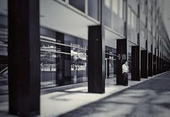 16-8 (vincentag) Tags: 16 8 modern architecture pillars glass metal ground building paris la défense man standing