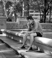 Reader (Dalliance with Light (Andy Farmer)) Tags: philadelphia ilfordhp5 philly book zeiss50mmplanart hc110dilb park bw nikonfm2 film street pennsylvania unitedstatesofamerica rittenhousesquare