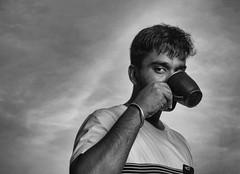 Evening Tea (Bhuvan N) Tags: portrait sky blackandwhite bw monochrome clouds portraits outdoors mono friend ciel ocf dramaticsky bnw portraitproject bwportrait portraitseries strobist absoluteblackandwhite bnwportrait godox godoxtt600 kaapilota tea cielo teacup