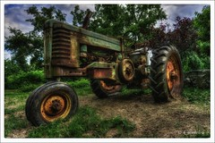 Jolly Green Giant (* Gemini-6 * (on&off)) Tags: hdr framed green sky clouds tractor rust patina wideangle lowangle wheels