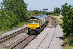 Escort Shed (JohnGreyTurner) Tags: br rail uk railway train transport newbarnetby lincolnshire lincs 66 class66 shed gbrf cargorail t66404 import diesel engine locomotive cargolink cargonet beacon
