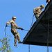 A Soldier attending Air Assault School jumps from a 58-foot tower for the first time as he rappels down a rope