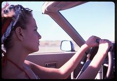 Danna on I-40 West (tobysx70) Tags: nikon f2 photomic kodak kodachrome 25 35mm 135 color slide film rollfilmweek july 2019 danna i40 west interstate 40 route 66 rt rte arizona az new mexico nm southwest woman female portrait profile bandana freeway road trip driving nissan 300 zx convertible ttop day2 toby hancock photography