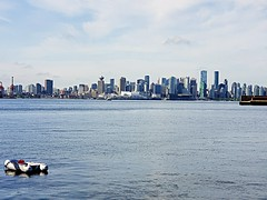 The Vancouver Skyline (walneylad) Tags: vancouver britishcolumbia canada portofvancouver city downtown skyline cityscape burrardinlet pacificocean sea ocean water buildings urban scenery view landscape waves clouds bluesky sun july summer boat dinghy waterfrontpark canadaplace seabus