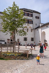 Molly and Jodie outside the St Georgs Kirche (timnutt) Tags: molly fun österreich austria city fujifilm osterreich x100 fortress people toddler x100t fuji bavaria child baby festung fort osterreichsalzburg
