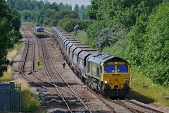 Passengers and Freight (ii) (JohnGreyTurner) Tags: br rail uk railway train transport 66 class66 shed freight goods brocklesby lincolnshire lincs diesel engine locomotive coal hoppers tpe transpennine express