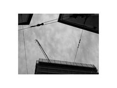 looking up geometry (Armin Fuchs) Tags: arminfuchs lavillelaplusdangereuse würzburg sky clouds constructionsite houses crane diagonal huawei smartphone