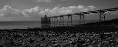 Between a Rocky and a Cloudy Place (JamieHaugh) Tags: clevedon somerset england uk gb britain outdoors bristol sony alpha ilce7rm2 a7rii zeiss channel estuary clouds rocks beach coast coastal pier water sky architecture pebbles seaside blackandwhite blackwhite bw black white monochrome mood atmosphere horizon dof seascape