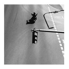 Anonymous Biker (Thomas Listl) Tags: thomaslistl blackandwhite biancoenegro noiretblanc monochrome square motorbike biker motorcyclist trafficsigns road street summer romanticsolitude urban shadows lines anonymousvisitor