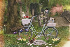 On a bike that takes you everywhere (Rose Sternberg) Tags: second life deco decor home garden interior landscape july 2019 tm creation spring bike scene with decors gp18 basket tulips flowers plants rocks cats radio suitcase