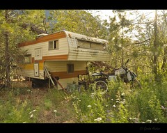 timber (Gordon Hunter) Tags: camper tree rv travel home shelter camp camping motorbike motorcycle dirt bike abandoned canada country rural plants wind blow warm glow gord hunter nikon d5000