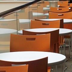lunch room queue (Jim_ATL) Tags: chairs orange reflection cafeteria aquarium atlanta
