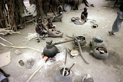 79-382 (ndpa / s. lundeen, archivist) Tags: nick dewolf color photograph photographbynickdewolf 1976 1970s film 35mm 79 reel79 africa northernafrica northeastafrica african ethiopia ethiopian southernethiopia riverlife village people localpeople villagelife utensils bowl bowls cooking openfire fire flames firepit woman mother nursing child baby infant children kids eat eating youngwoman necklaces beads pail bucket women localwoman localwomen tribe southerntribe