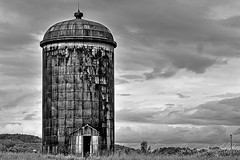 Rustic Silo BW (Susan Candelario) Tags: bw clouds delaware landscape monochromatic nj newjersey northamerica old rural sussexcounty unitedstates abandon abandonment agriculture architectural architecture black chamber cloudy country day daytime farm farmland farms furniture grain granary mono monochrome neglect neglected orange oxidation oxide rust rustic silo steel storm stormy stucutur stucuture suburban tower white