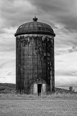 Rusted Silo BW (Susan Candelario) Tags: bw clouds delaware landscape monochromatic nj newjersey northamerica old rural sussexcounty unitedstates abandon abandonment agriculture architectural architecture black chamber cloudy country day daytime farm farmland farms furniture grain granary mono monochrome neglect neglected orange oxidation oxide rust rustic silo steel storm stormy stucutur stucuture suburban tower white