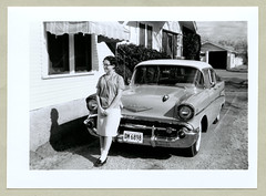"""1957 Chevrolet Bel Air (Vintage Cars & People) Tags: auto woman white black classic cars chevrolet girl car fashion lady vintage photography photo automobile foto fifties antique chevy 1950s vehicle sw motor 50s 1957chevrolet """"blackwhite"""" curlers lockenwickler socks skirt loafers glasses spectacles suburbia suburbs house home awning garage blouse"""