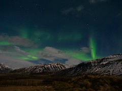 Aurora (Caleb Bertolini) Tags: iceland northern lights aurora olympus golden circle winter snow mountains long exposure tripod m43 micro four thirds borealis field landscape sky night colors blue green color mountain nature natural