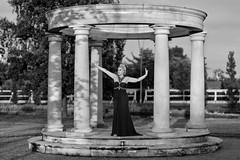 Dance in a park (piotr_szymanek) Tags: malgosia malgosiat woman blackandwhite outdoor face columns colosseum portrait dress hand dance 1k 20f 50f 5k 10k 100f