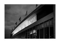 Lost Identity (Thomas Listl) Tags: thomaslistl blackandwhite biancoenegro noiretblanc night dark london uk england greatbritain 35mm grain grey architecture light building windows clouds diagonal lines mood facade