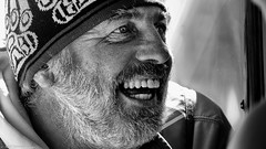 Everyone has a story. (Neil. Moralee) Tags: neilmoralee man face portrait bright sunlight sunshine smile teeth hat beard old mature close canada vancouver island sailor seaman eye eyes black white blackwhite blackandwhite bw mono monochrome neil moralee nikon d7200 candid street happy feeling joy mirth laughter laughing moustache male tofino british columbia working