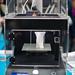 3D printer printing a figure